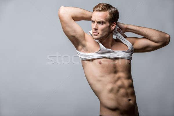 Muscular man in studio  Stock photo © bezikus