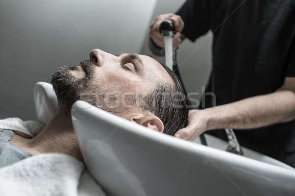 Mosás fej férfi csukott szemmel szakáll hazugságok Stock fotó © bezikus