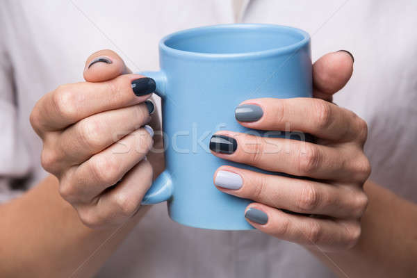 Female hands with blue cup Stock photo © bezikus