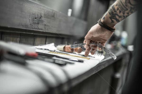 Hand with straight blade Stock photo © bezikus