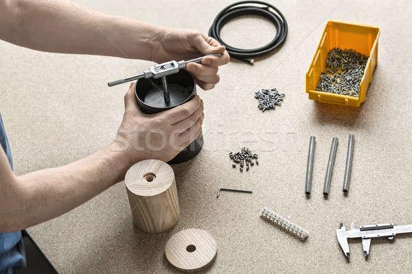 Guy using wrench in workshop  Stock photo © bezikus