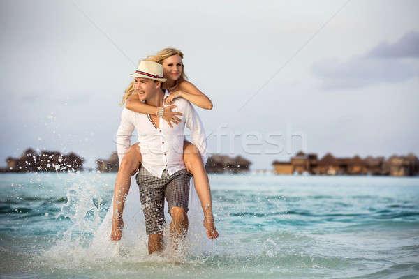 Menyasszony lovaglás vőlegény boldog pár Maldív-szigetek Stock fotó © bezikus