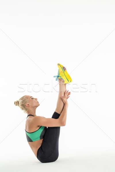 Rhythmic gymnast doing exercise in studio. Stock photo © bezikus
