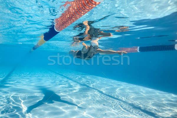 Donna subacquea incredibile femminile nuotatore piscina Foto d'archivio © bezikus