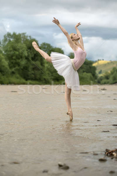 Ballerina posing in river Stock photo © bezikus