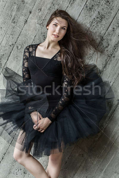 Portrait of a beautiful belt brunette ballerina in tutu Stock photo © bezikus