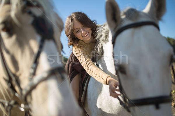Beautiful girl riding a horse Stock photo © bezikus