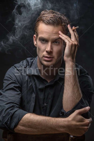 Portrait of man with cigarette Stock photo © bezikus