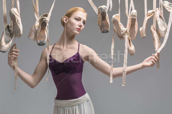 Stock photo: Blonde ballerina and pointe shoes