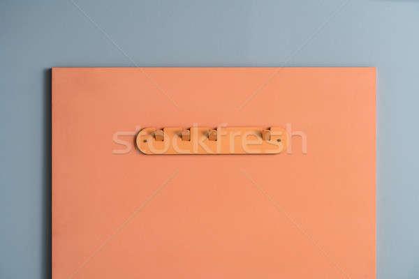 Metal pomarańczowy wieszak elegancki metaliczny Brzoskwinia Zdjęcia stock © bezikus