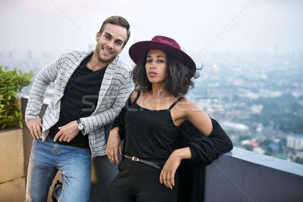 Gyönyörű pár erkély csinos városkép fekete Stock fotó © bezikus