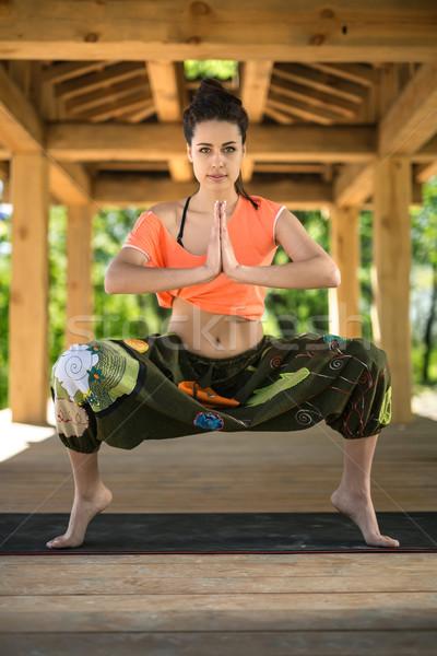 Girl is engaged in yoga Stock photo © bezikus