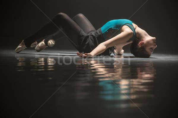 Ballet dancer lying on the floor Stock photo © bezikus
