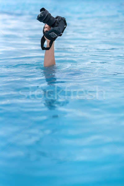 Hand with camera over geothermal pool outdoors Stock photo © bezikus