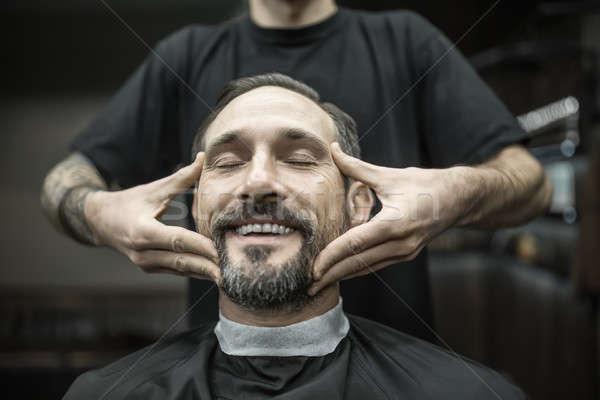 顔 マッサージ 笑みを浮かべて 男 あごひげ ストックフォト © bezikus