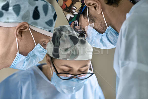 Stock photo: Doctors in operating room