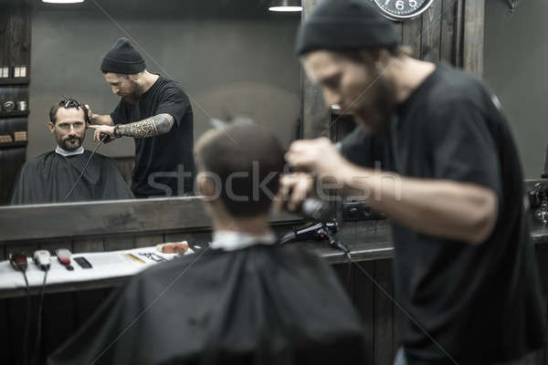 Stock photo: Cutting hair in barbershop