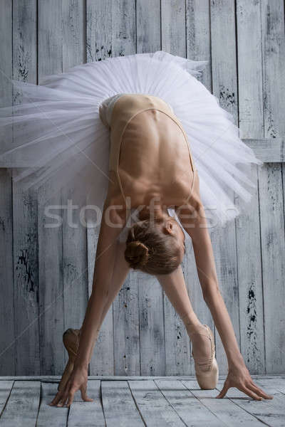 Ballerina dressed in white tutu makes lean forward Stock photo © bezikus