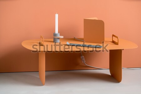 Metal orange table with lamp and accessories Stock photo © bezikus
