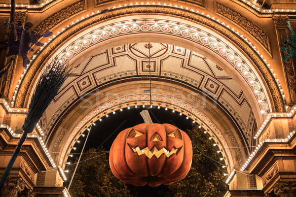 Big Halloween pumpkin hanging in archway Stock photo © bezikus