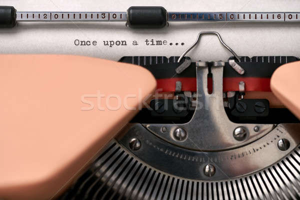 Stock photo: Vintage typewriter coral color in studio, close up.