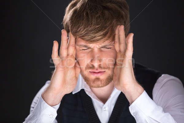 Fejfájás fáradt jóképű férfi kezek arc érzés Stock fotó © bezikus
