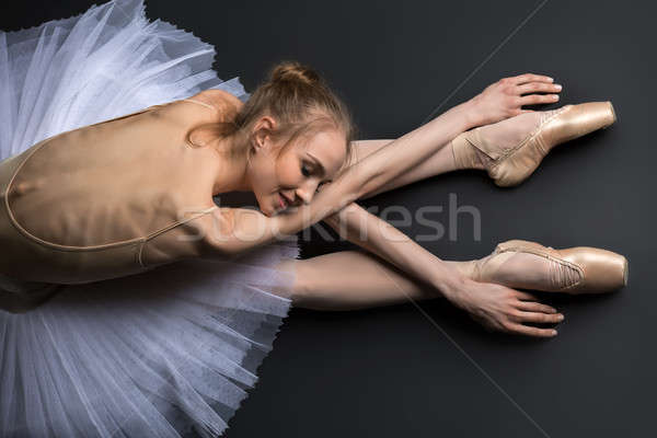 Graceful ballerina sitting on the floor Stock photo © bezikus