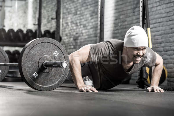 Pushup workout in gym Stock photo © bezikus