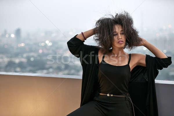 красивая девушка позируют балкона очаровательный девушки Сток-фото © bezikus