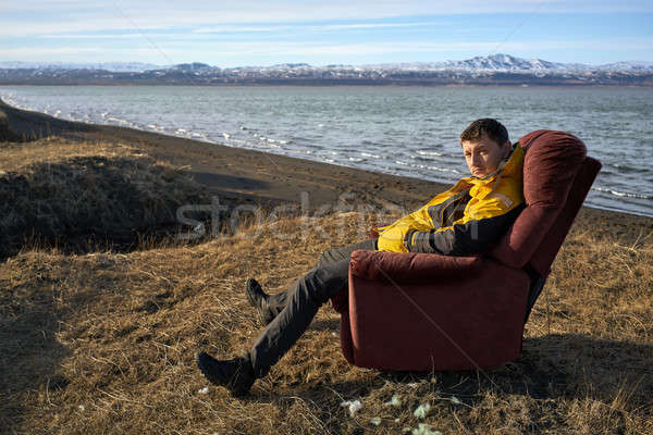 Stock photo: Man sits on armchair outdoors