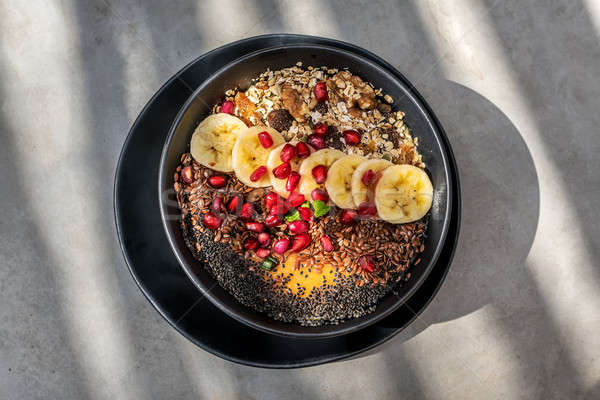Gyümölcs mix tál trópusi étel keverék fekete Stock fotó © bezikus