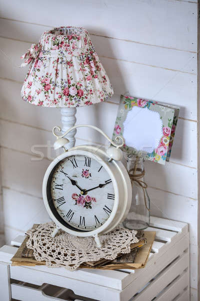 Bedside table with lamp and alarm clock Stock photo © bezikus