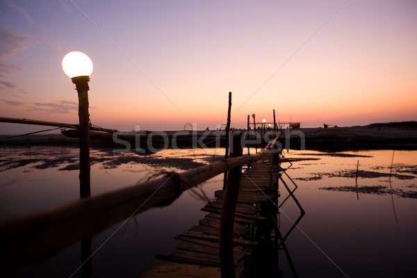 Foto stock: Pôr · do · sol · goa · ponte · rio · praia
