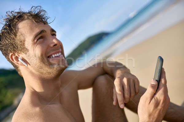 Tanned guy on beach Stock photo © bezikus
