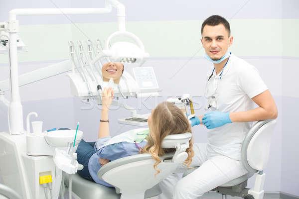 стоматолога пациент улыбаясь стоматологических белый Сток-фото © bezikus