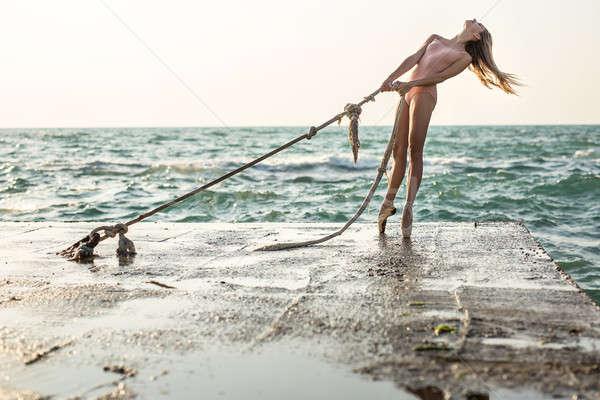 Ballerina posing on seafront Stock photo © bezikus