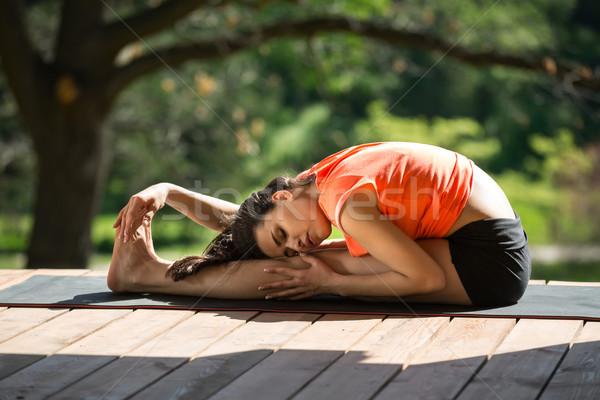 Lány ülő előre kanyar eljegyezve jóga Stock fotó © bezikus