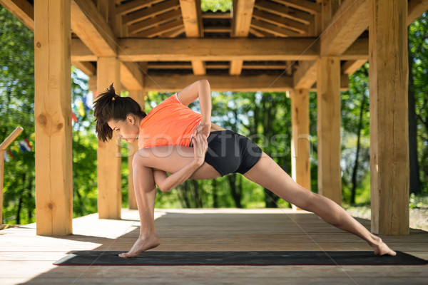 Girl makes low lunge Stock photo © bezikus