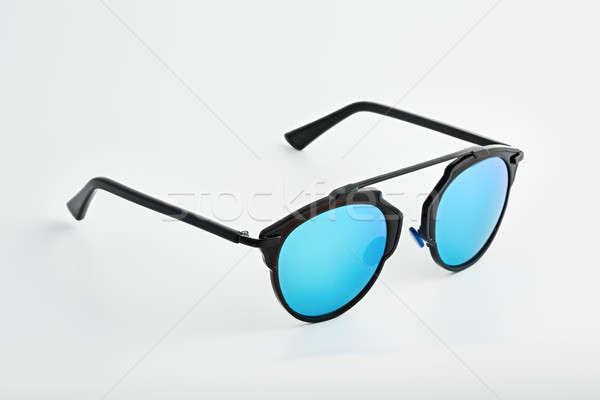 Stylish glasses with blue tinted mirror Stock photo © bezikus