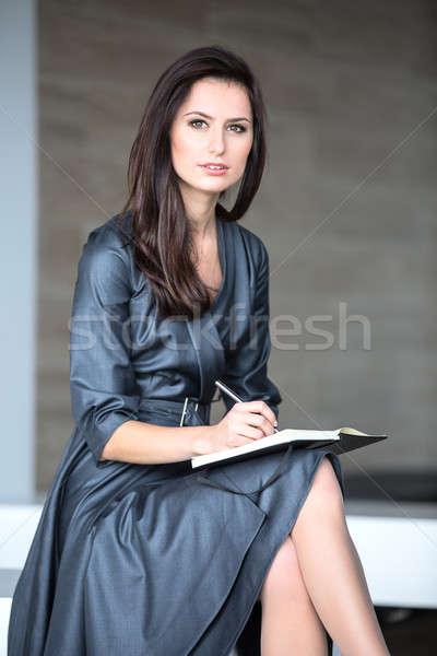 Pretty girl in a gray suit Stock photo © bezikus