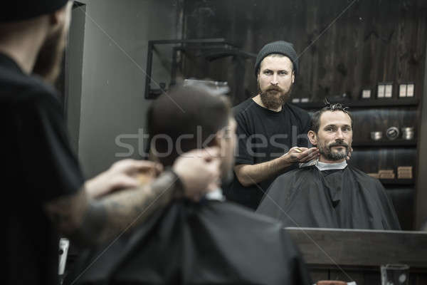 Stylish man in barbershop Stock photo © bezikus