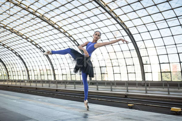 Attractive ballerina posing outdoors Stock photo © bezikus