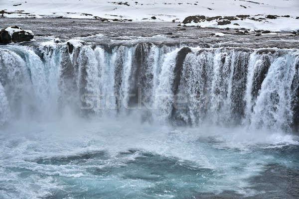 Tájkép vízesés elképesztő fagyott part Izland Stock fotó © bezikus
