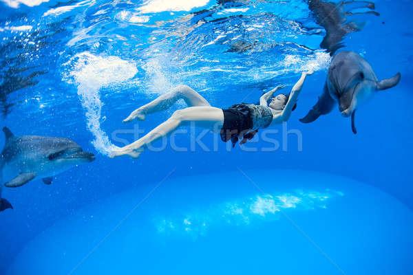девушки дельфины воды глазах волос поцелуй Сток-фото © bezikus