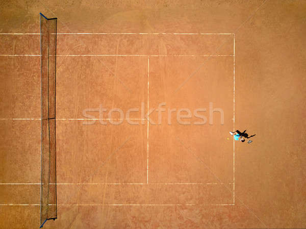 Sportive girl plays tennis Stock photo © bezikus