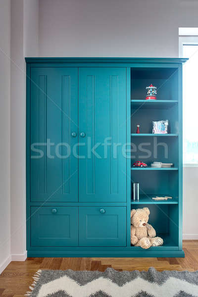 Children's bookcase with toy Stock photo © bezikus