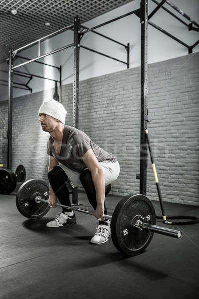 Crossfit edzés súlyzó szakállas férfi tornaterem Stock fotó © bezikus