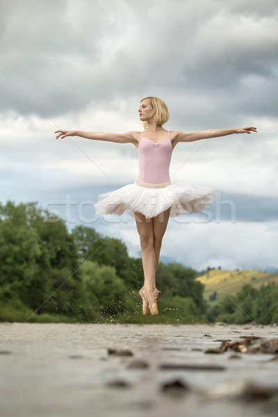 Stock photo: Ballerina jumping above river