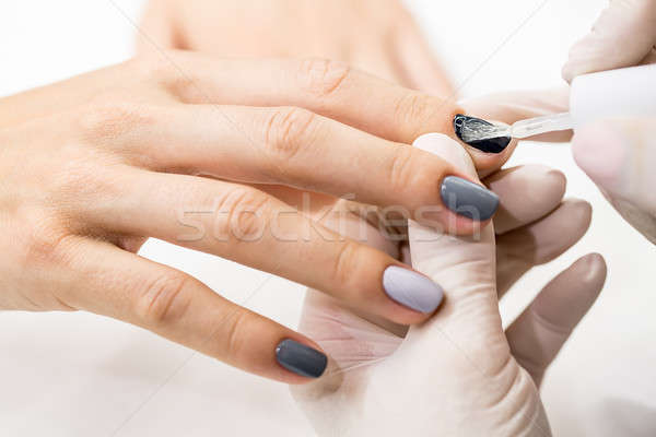 Master gets a new paint gray fingers on different  Stock photo © bezikus