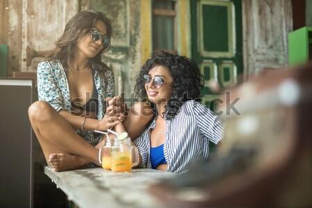 Nők megnyugtató kávézó boldog lányok kanapé Stock fotó © bezikus